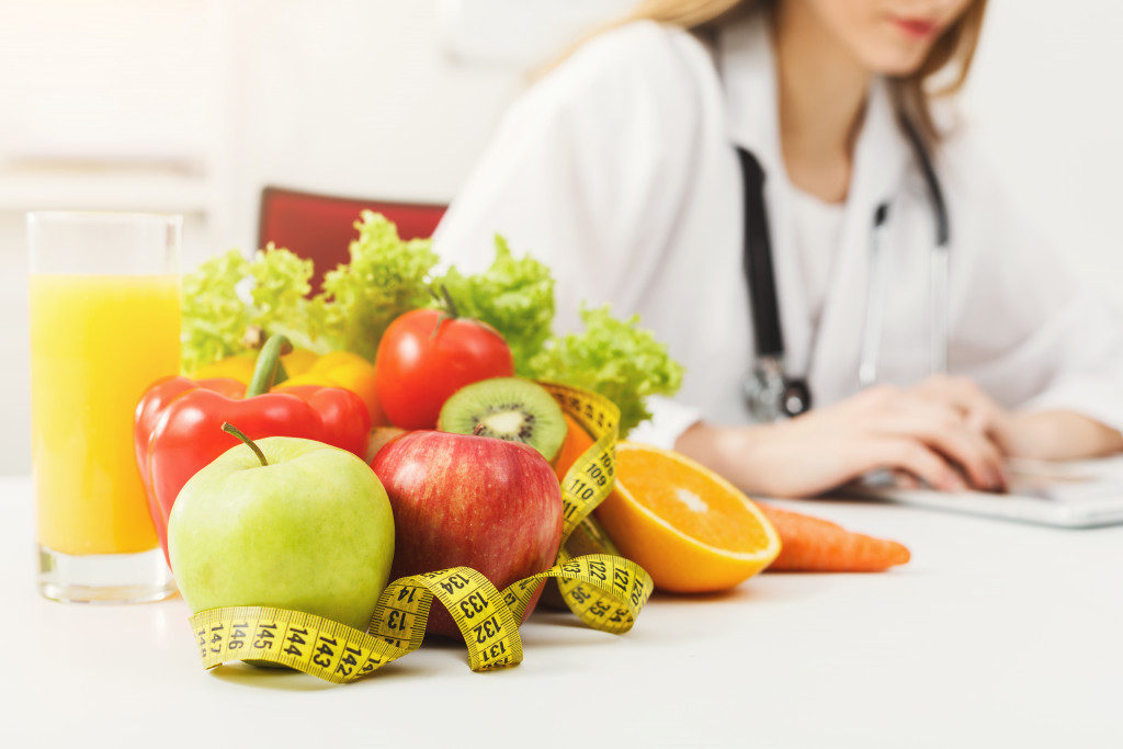Nutritionist with fruits and juice