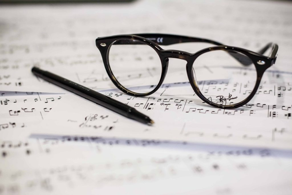 Music notes and eyeglasses