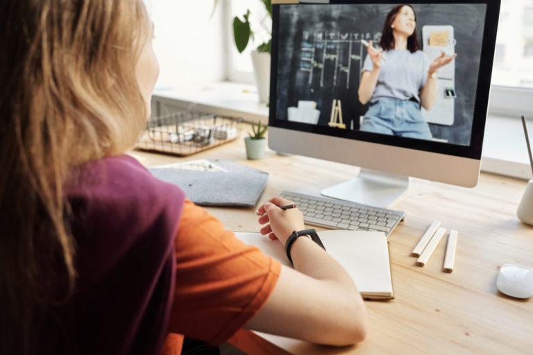 young girl attending online class