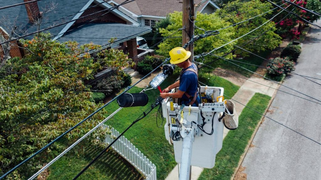 electrician working on electrical pole