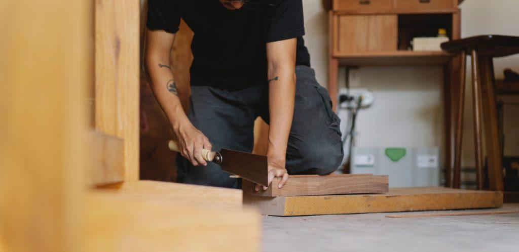 man working as carpenter