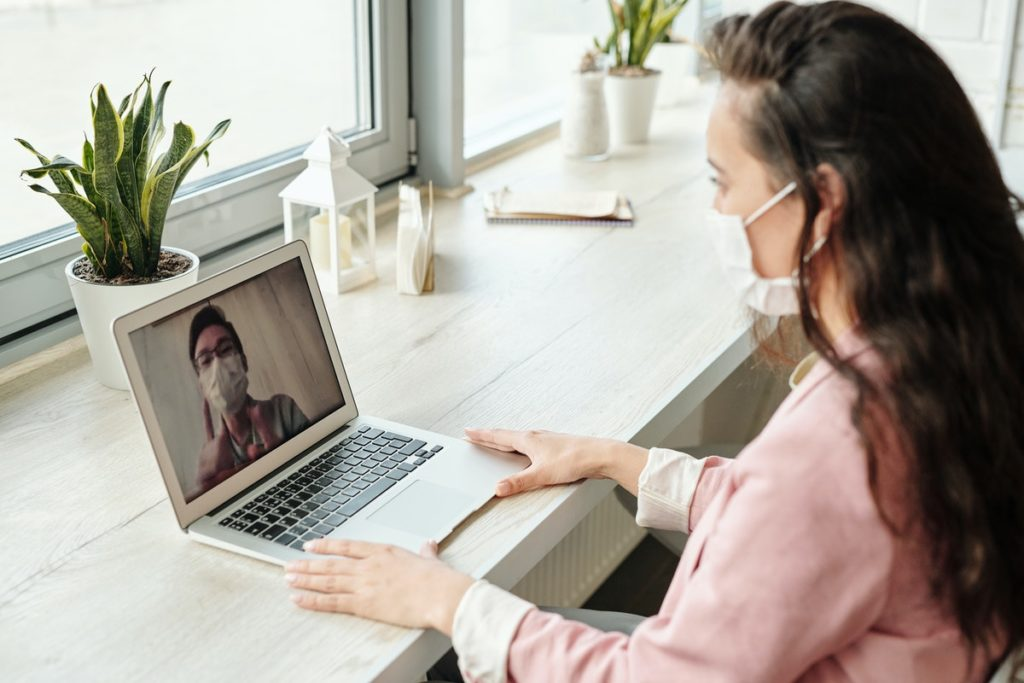 isolated woman doing a video conference